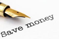La pluma encendido ahorra el texto del dinero Imagenes de archivo