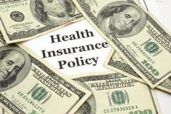 La política del seguro médico cuesta efectivo Foto de archivo libre de regalías