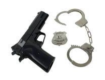 La policía Badge el arma y las manillas Foto de archivo libre de regalías