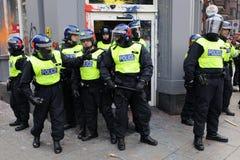 La policía de alboroto en Londres Anti-Cortó protesta Imagen de archivo libre de regalías