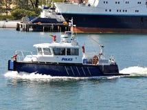 La policía enciende el barco Imagen de archivo libre de regalías