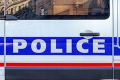 La policía manda un SMS en puerta de coche Imagen de archivo