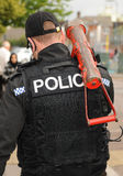 La policía contiene la entrada Imagen de archivo libre de regalías