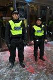 La policía de alboroto en Anti-Cortó protesta en Londres Imagen de archivo