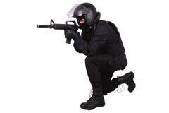 La police anti-émeute commandent dans l'uniforme noir Images libres de droits