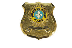 La police Badge le QUÉBEC CARRÉ Photo stock