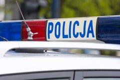 La police polonaise se connecte un toit de voiture de police photos libres de droits