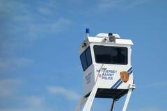 La polizia guarda la torre Fotografie Stock