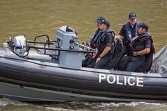 La polizia lancia Immagini Stock