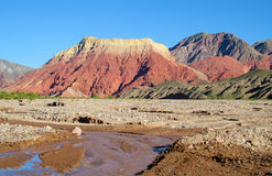 La pollera de la coya, red mountain in Argentina. Red color mountains. La pollera de la coya, red mountain in Argentina in Quebrada de Humahuaca, river near the Royalty Free Stock Images