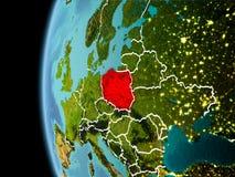 La Polonia da spazio nella sera Fotografie Stock