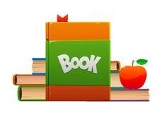 La pomme rouge sur une pile de bande dessinée de livres objecte photo libre de droits