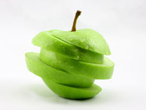 La pomme verte coupée en tranches Photo libre de droits