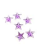 La porpora stars i coriandoli fotografie stock