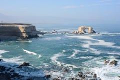 La Portada (Arch Rock) in Antofagasta, Chile. Arch Rock Formation in La Portada National Reserve is an emblem of Chilean Coast Stock Photos
