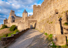 La Porte De Aude and cross at late afternoon in Carcassonne Stock Photography