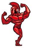 La posa spartana e mostra il suo grande muscolo Immagini Stock
