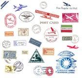 La posta aerea dell'annata contrassegna e timbra Fotografie Stock