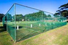 La pratique en matière de cricket prend le jeu au filet de guichets Photo stock