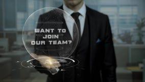 La presentación del profesor particular de la profesión quiere unirse a nuestro concepto del equipo con el holograma en su mano almacen de video