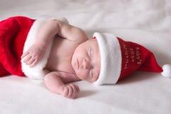 La primera Navidad del bebé Fotos de archivo
