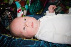 La primera Navidad del bebé Imagenes de archivo