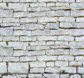 la priorità bassa colora la parete di pietra del grunge Molte pietre fotografia stock