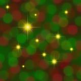 La priorità bassa verde rossa con oro stars il twinkling Immagini Stock