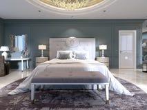 La progettazione moderna della camera da letto con un grande letto bianco e di un panchetto con una tavola vestentesi vicino le p illustrazione di stock