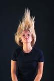 La projection blonde de femme sa se dirigent en arrière Photo stock