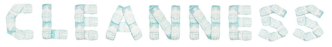 La propreté de Word a présenté des couches-culottes de bébé sur un fond blanc, isolat, serviette, inscription image stock
