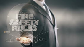 La protezione antincendio governa le nuove tecnologie disponibile di Holding dell'uomo d'affari Fotografia Stock