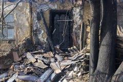 La puerta de entrada carbonizada Fotos de archivo