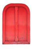 La puerta roja aislada en el fondo blanco Imagenes de archivo