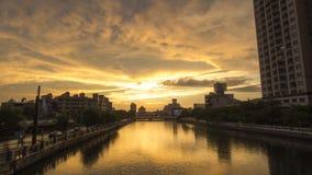 La puesta del sol en el canal de Tainan Imagen de archivo