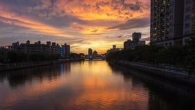 La puesta del sol en el canal de Tainan Imagenes de archivo