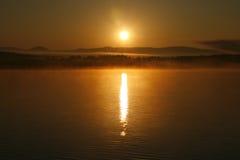 La puesta del sol en el lago Fotografía de archivo libre de regalías