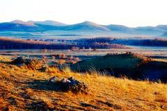 La puesta del sol otoñal del prado Imágenes de archivo libres de regalías