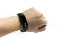 La pulsera 2 de Xiaomi, artilugio usable en la muñeca para hombre aisló el fondo blanco Imagen de archivo