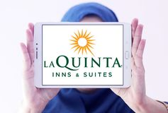 La Quinta Inns and Suites logo. Logo of La Quinta Inns and Suites on samsung tablet holded by arab muslim woman. La Quinta is a chain of limited service hotels royalty free stock photography