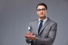 La récompense d'étoile de participation d'homme d'affaires dans le concept d'affaires Photo libre de droits