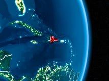 La République Dominicaine en rouge la nuit Image libre de droits