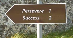 La réussite suit la persévérance. Photos stock