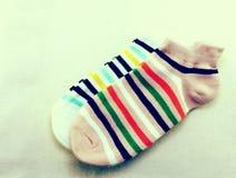 La raccolta dei calzini colorati con l'annata filtra l'effetto Immagini Stock
