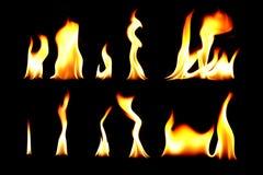 La raccolta di fuoco, falò sulla luce nera del fondo Immagine Stock