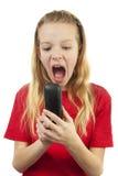 La ragazza è arrabbiata sul telefono Immagine Stock Libera da Diritti