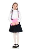 La ragazza è una scolara con un libro in sue mani Immagine Stock