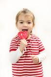 La ragazza allegra con la lecca-lecca Fotografie Stock
