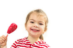 La ragazza allegra con la lecca-lecca Fotografia Stock