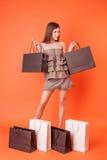 La ragazza allegra vuole comprare tutto Fotografie Stock Libere da Diritti